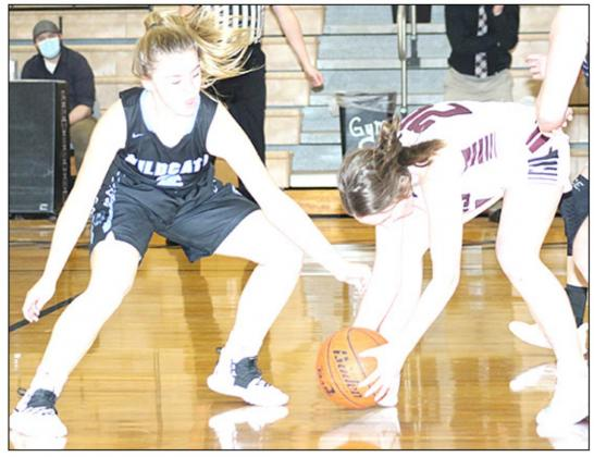 LHS' Carleigh Weyers (#24, right) picks up a quick steal in Friday night's game against Cedar Bluffs. Weyers scored 15 points and had 9 steals in the game. Paula Jasa/Republican