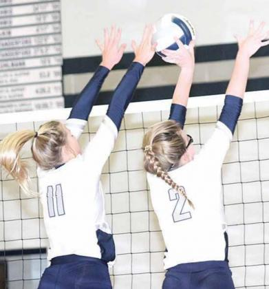 HTRS' Katilyn Glathar (#11, left) and Aly Howe (#2, right) get their hands on a double ace block. Paula Jasa/Republican